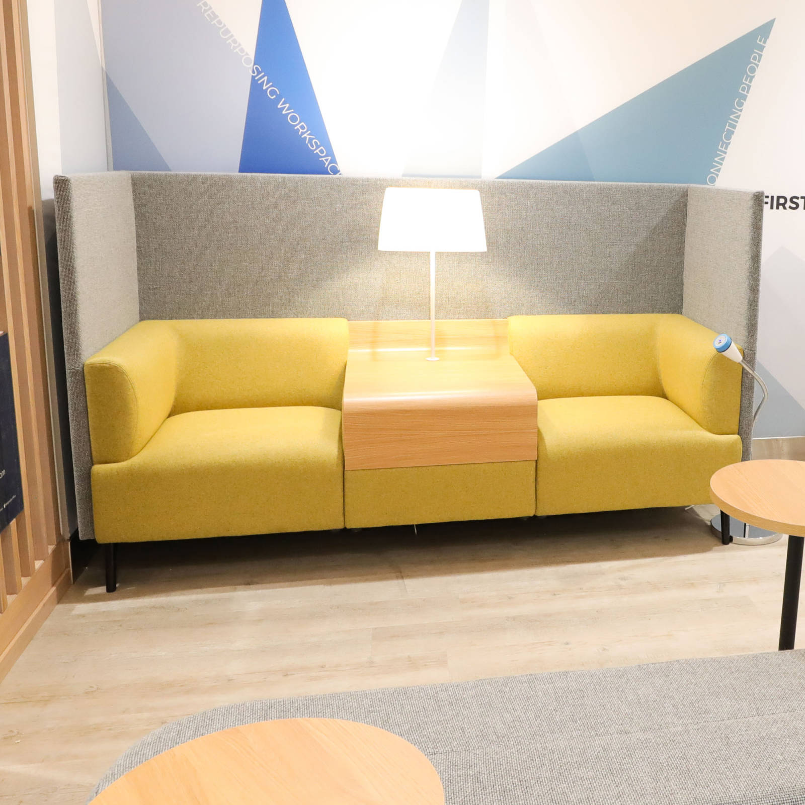 yellow sofa with high grey back at belfast city airport